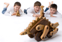 Niels, Michiel and Simon playing with the wooden dinosaurs - wooden toys - Woodix Toys ©2008